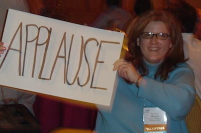 woman holding applause sign